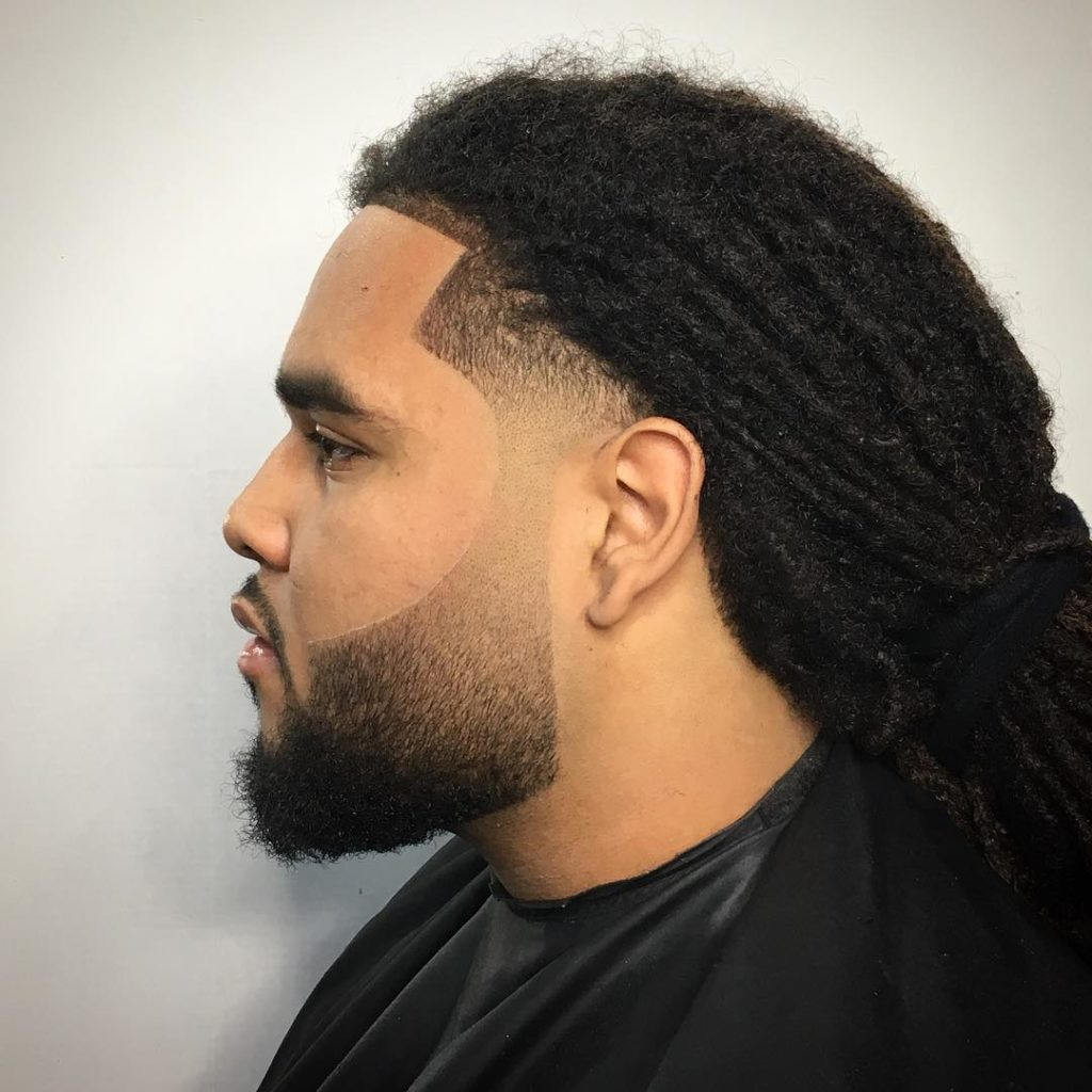 dreadlocks en pelo largo de hombre