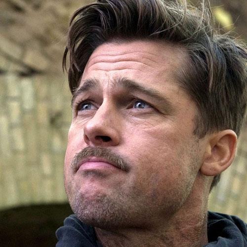 Brad-Pitt-Inglourious-barba desordenada y peinado hacia un lado
