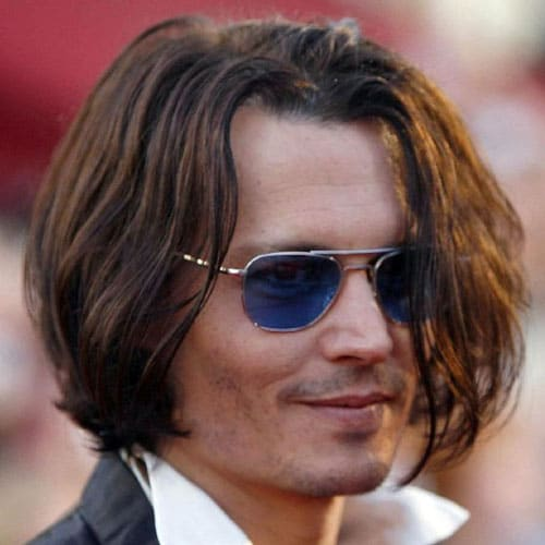 Johnny Depp pelo largo y bigote