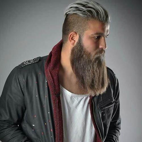 Barba de leñador en hombre joven con corte de pelo moderno