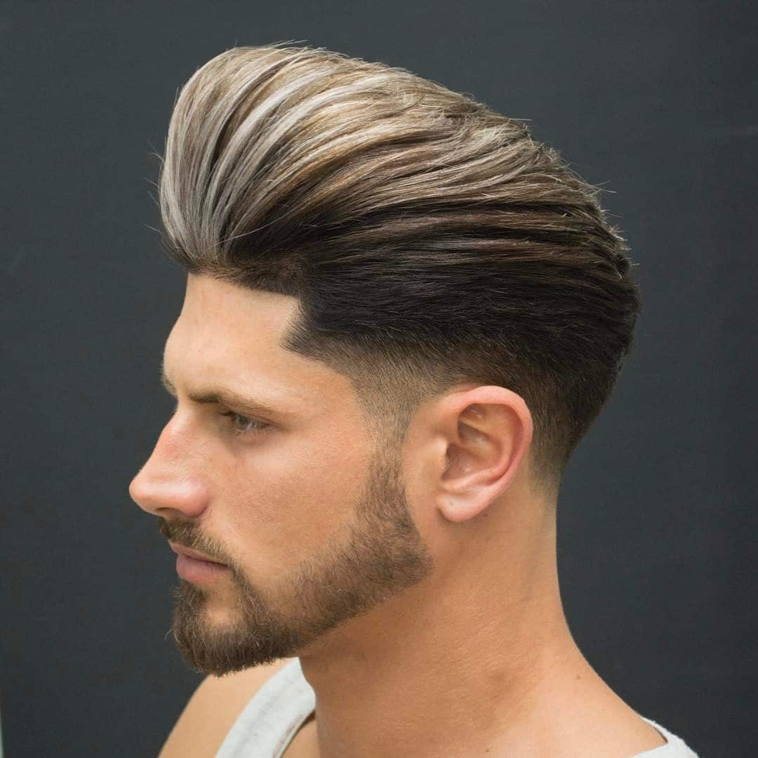 Corte de pelo con volumen y degradado a los lados con barba