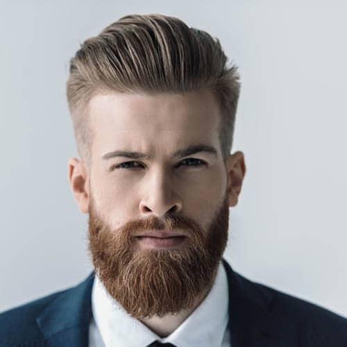 Hombre guapo con barba mediana y peinado hacia atras