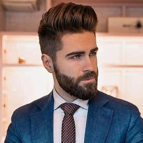 Hombre guapo con corte de pelo moderno y barba