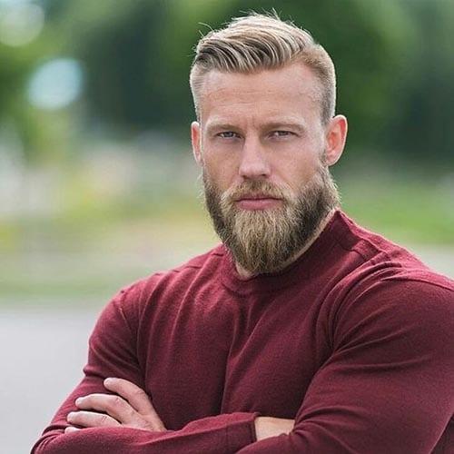 barba de leñador en hombre joven rubio con corte de cabello a la moda